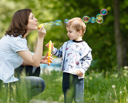 mother_son_blowing_bubbles_lung_awareness_COPD_disease_carmi_pentiicton_remedy's_rx_pharmacy